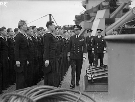 King George VI visiting the Home Fleet at Scapa Flow in March 1943 The King Pays 4-day Visit To the Home Fleet. 18 To 21 March 1943, at Scapa Flow, the King, Wearing the Uniform of An Admiral of the Fleet, Paid a 4-day Visit To the Home Fleet. A15119.jpg