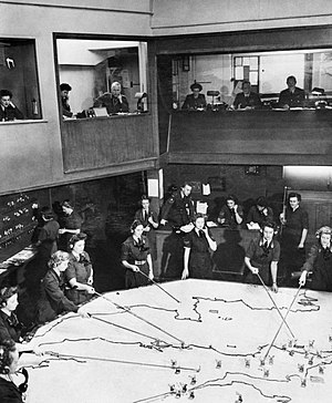 Plotter (RAF) - The Operations Room at RAF Fighter Command's No. 10 Group Headquarters, Rudloe Manor (RAF Box), Wiltshire, showing WAAF plotters and duty officers at work, 1943