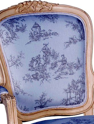 Toile - A photo of toile de jouy fabric on a French reproduction style chair.