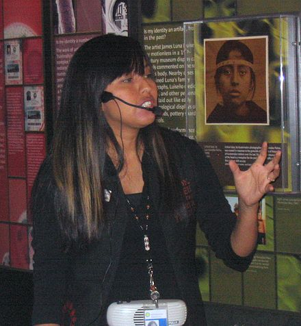 A tour guide in the National Museum of the American Indian