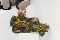 Toy camouflaged searchlight truck (25449316752).jpg
