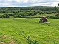 Tractor and field with forest on the horizon - geograph.org.uk - 852434.jpg