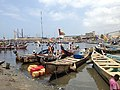 Traditional fishermen coming in to Tema harbour 01.jpg