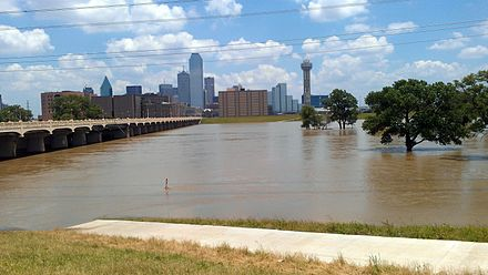 The Trinity River in Dallas flooded up to the levees in June 2015. Seen from the Commerce Street bridge. Trinity Flooded June 2015.jpg