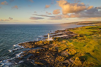 Turnberry (golf course) - Turnberry Lighthouse at sunset surrounded by the golf course.