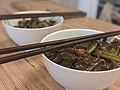 Two bowls of soba noodles with chopsticks 2.jpg