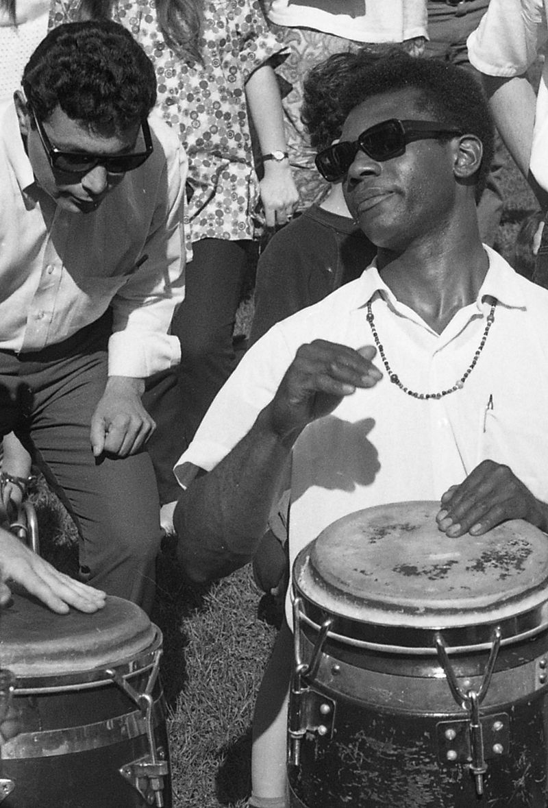 Two hand drummers, both wearing sunglasses, about 1966.jpg