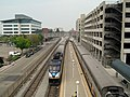 Two trains at Jack London Square station, September 2017.JPG
