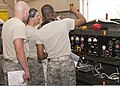 U.S. Air Force Senior Airmen Alfred Fyvie, Joshua Ruberg and Mister Braxton, all with the 361st Training Squadron, check the wiring diagram panel to troubleshoot an electrical problem June 8, 2011, at Sheppard 110608-F-NS900-029.jpg