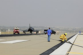 U.S. Airmen assigned to the 39th Operations Squadron and the 39th Civil Engineer Squadron inspect cables on a BAK-12 aircraft arresting barrier system Feb. 24, 2014, at Incirlik Air Base, Turkey 140224-F-IM659-149.jpg