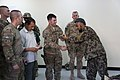 U.S. Army Capt. Matthew Schneider, center, a physician assistant with the 122nd Engineer Battalion, South Carolina Army National Guard, presents a certificate of completion and a tourniquet to an Afghan National 130613-A-XM609-062.jpg