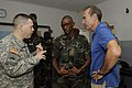 U.S. Army Lt. Col Steven Metze, left, with the 3rd Infantry Division, Texas National Guard, speaks with Lt. Col. Ibrahima Sory Bangoura, center, the operations commander for the Guinea armed forces, through 120711-Z-KE462-009.jpg