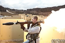 U.S. Army Spc. James Lindermen, with Headquarters and Headquarters Company, 1st Battalion, 4th Infantry Regiment, fires a rocket-propelled grenade while participating as part of a simulated opposing forces team 130319-A-TA386-004.jpg