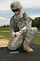 U.S. Army Spc. Russell Williams, assigned to the 108th Training Command, loads ammunition into a clip as he prepares to qualify with his M4 rifle during the 2013 Army Reserve Best Warrior Competition at Fort 130626-A-EA829-024.jpg