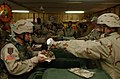 U.S. Army soldiers line up for Thanksgiving dinner at Camp Cobra in Iraq.jpg
