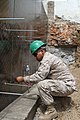 U.S. Marine Corps Pfc. Luis Maranon, with the 9th Engineer Support Battalion, 3rd Marine Logistics Group, III Marine Expeditionary Force, works on a frame for concrete during renovation work at Erdmiin Oyun High 130727-M-DR618-086.jpg