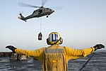 U.S. Navy Aviation Boatswain's Mate (Handling) 2nd Class Joseph Foreman directs an MH-60S Seahawk helicopter attached to Helicopter Sea Combat Squadron (HSC) 7 on the flight deck of the aircraft carrier USS 131002-N-GR168-007.jpg