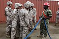 U.S. Navy BM1 Antonio Dix (right) from Navy Cargo Handling Battalion, teaches U.S. Marines from Combat Logistics Battalion 8, Transportation Support Company, about endless nylon slings during the Expeditionary 120613-M-KS710-012.jpg