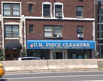 Word play - Many businesses use word play to their advantage by making their business names more memorable.  This business is located near the United Nations Headquarters and plays on the term UN Peacekeepers.