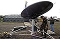 US Navy 030403-N-9693M-004 Electronics Technician 2nd Class Kristian Dillemouth stows a USC-60A satellite dish.jpg