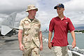 US Navy 030716-N-3228G-006 U.S. Marine Cpl. Quentin Gwynn, a support equipment technician aboard the amphibious assault ship USS Bonhomme Richard (LHD 6) gives a tour of the ship to 16 year-old Adam Smith.jpg