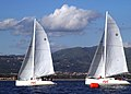 US Navy 031209-N-3503S-002 The U.S. Sailing Team jockeys for position and tries to find the best wind during the 6th race of the 3rd World Military Games sailing competition.jpg