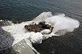 US Navy 040426-N-3211R-003 An Amphibious Assault Vehicle disembarks the Wasp class amphibious assault ship USS Bonhomme Richard (LHD 6).jpg