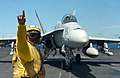 US Navy 040904-N-5821P-034 Aviation Boatswain's Mate 1st Class Sidney Jones guides an F-A-18C Hornet.jpg