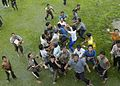 US Navy 050101-N-1229B-199 Indonesian refugees gather under an approaching helicopter to receive food and supplies.jpg
