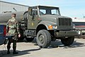 US Navy 050124-N-4397B-001 A Seabee, assigned to Naval Mobile Construction Battalion One (NMCB-1), weighs a water truck.jpg