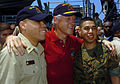 US Navy 050220-N-5067K-056 Former President William J. Clinton poses with Chief Operations Specialist David C. McAlister, left, and Lance Cpl. Angelo D. Jimenez aboard the amphibious dock landing ship USS Fort McHenry (LSD 43).jpg
