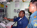 US Navy 050524-N-4104L-008 Gas Turbine System Technician 3rd Class Michael Simmons explains the propulsion auxiliary control console aboard the guided missile destroyer USS Paul Hamilton (DDG 60) to Indonesian Navy Maj. Rudhi A.jpg