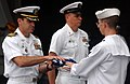 US Navy 050629-N-5345W-052 Commanding Officer, USS Harry S. Truman (CVN 75), Capt. James P. Gigliotti, left, is presented a folded ensign during a burial at sea ceremony.jpg