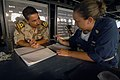US Navy 050704-N-4309A-418 Senior Chief Quartermaster Amy Coppedge gives navigation training to an Iraqi Navy officer aboard the amphibious dock landing ship USS Ashland (LSD 48).jpg