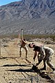 US Navy 061106-N-6999H-039 Sailors assigned to Naval Coastal Warfare Squadron Five (NCWS-5) and Explosive Ordnance Disposal Group One (EODG-1) work together to dig a foundation for a communications antenna to a joint task force.jpg