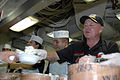 US Navy 070516-N-7128A-069 Former NASCAR driver Geoff Bodine serves ice cream with the First Class Petty Officer Association during an ice cream social aboard nuclear-powered aircraft carrier USS Nimitz (CVN 68).jpg