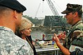 US Navy 070821-N-4515N-048 U.S. Transportation Secretary Mary E. Peters is briefed on Navy recovery efforts while touring the site of the I-35 bridge collapse over the Mississippi River.jpg