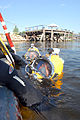 US Navy 080620-N-5329L-058 U.S. Navy divers from Mobile Diving and Salvage Unit (MDSU) 2 wait at the surface of the Providence River for the approval to begin a dive on the sunken former Soviet submarine Juliett 484 in Providen.jpg