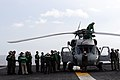 US Navy 080630-N-3659B-086 Flight deck personnel stand by as last minute maintenance is performed on an SH-60F Seahawk.jpg