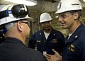 US Navy 080818-N-7090S-036 Cmdr. Donald Gabrielson, right, commanding officer of USS Freedom (LCS 1), speaks to crew members on the mess decks.jpg
