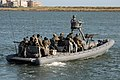 US Navy 090415-N-6403R-012 Special Warfare Combatant-Craft Crewmen (SWCC) assigned to Special Boat Team (SBT) 12 get underway on an 11-meter rigid-hulled inflatable boat for a training exercise.jpg