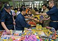 US Navy 090419-N-5253W-070 Sailors from Amphibious Squadron (PHIBRON) 11 and the Armed Forces of the Philippines Navy hand out toys.jpg