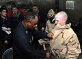 US Navy 090625-N-4015L-033 Damage Controlman 1st Class Kenneth Amaechi, assigned to the Damage Control Training Team of the aircraft carrier USS George Washington (CVN 73), demonstrates proper personnel decontamination procedur.jpg
