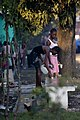 US Navy 100119-N-6266K-027 Two young Haitian women wash themselves outside their make-shift home outside Gheskio Field Hospital in Haiti.jpg