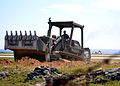 US Navy 100120-N-8241M-044 onstruction Mechanic 2nd Class Jacob Seichter operates a bulldozer at the airfield at Naval Station Guantanamo Bay.jpg