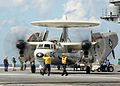 US Navy 100313-N-9793B-042 ailors assigned to the air department of the aircraft carrier USS George H.W. Bush (CVN 77) direct an E-2C Hawkeye.jpg