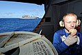 US Navy 100715-N-7191M-029 Aviation Boatswain's Mate (Handling) Devin Traxler, from Turlock, Ca., communicates on a sound-powered phone in the hanger bay aboard the aircraft carrier USS George Washington (CVN 73).jpg