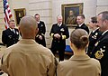 US Navy 100719-N-8273J-007 Chief of Naval Operations (CNO) Adm. Gary Roughead speaks with Sailors and Marines stationed at the U.S. Embassy in Paris.jpg
