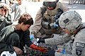 US Navy 101012-N-4345W-015 Hospital Corpsman 2nd Class Chris Lutton, assigned to Naval Mobile Construction Battalion (NMCB) 18, and a Soldier assig.jpg