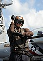 US Navy 110131-N-4973M-059 Aviation Electrician's Mate Airman Joel Blodgett relays pre-flight check signals.jpg